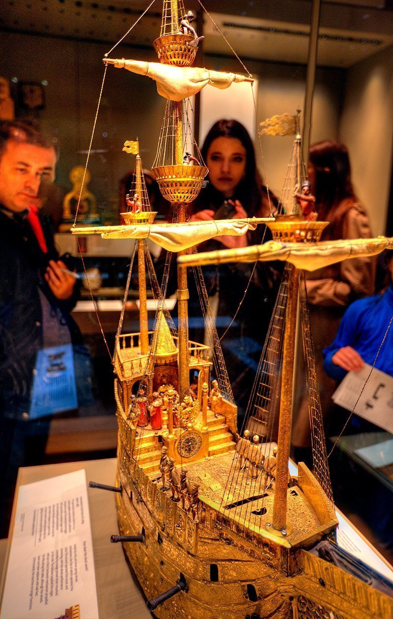 A functional galleon made out of gold, with moving pieces and working starboard cannons