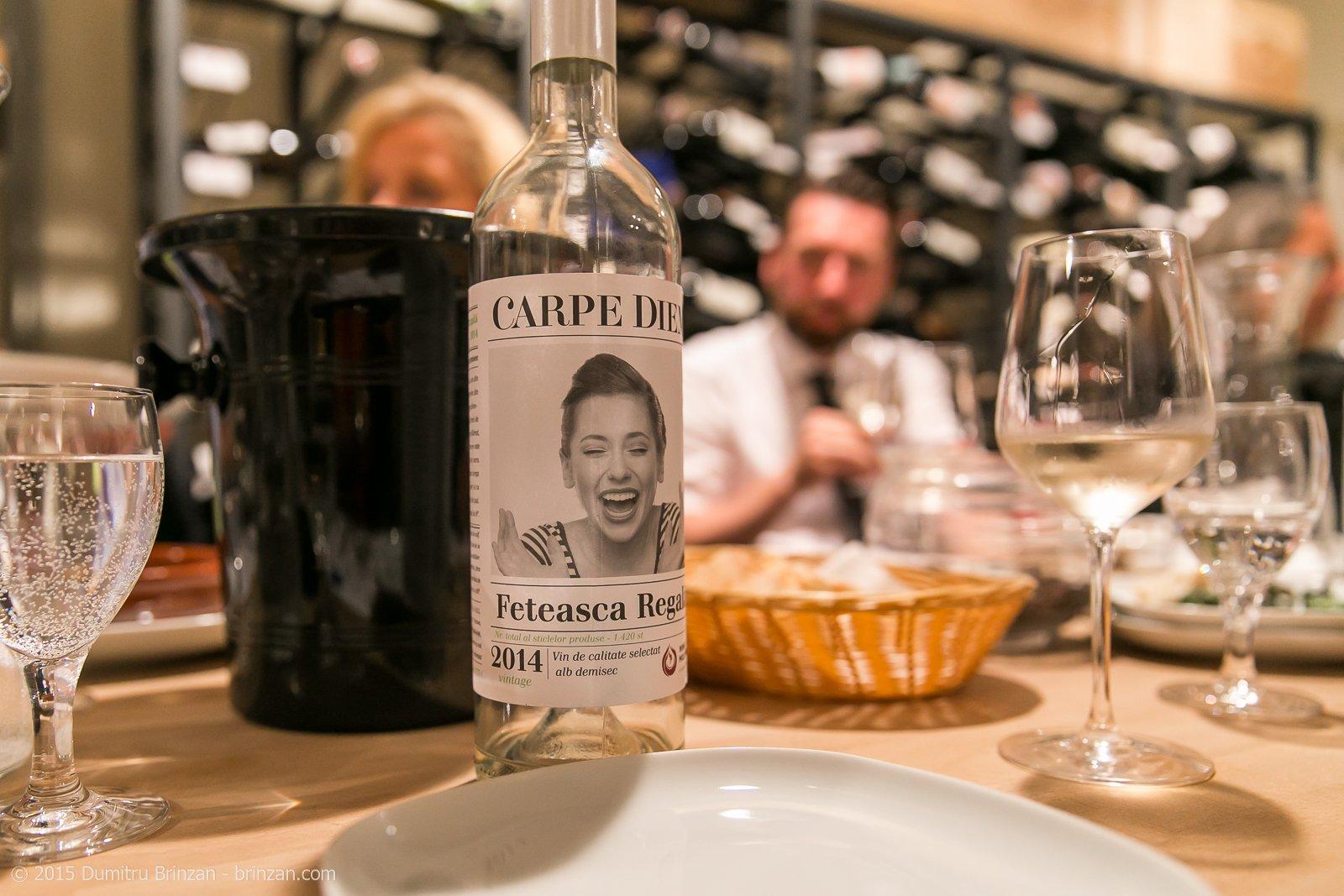 A bottle of Carpe Diem Feteasca Regala 2014 on a Table
