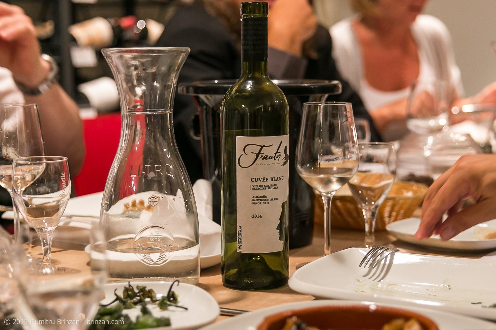 A bottle of F'autor Cuvee Blanc 2014 on a Table