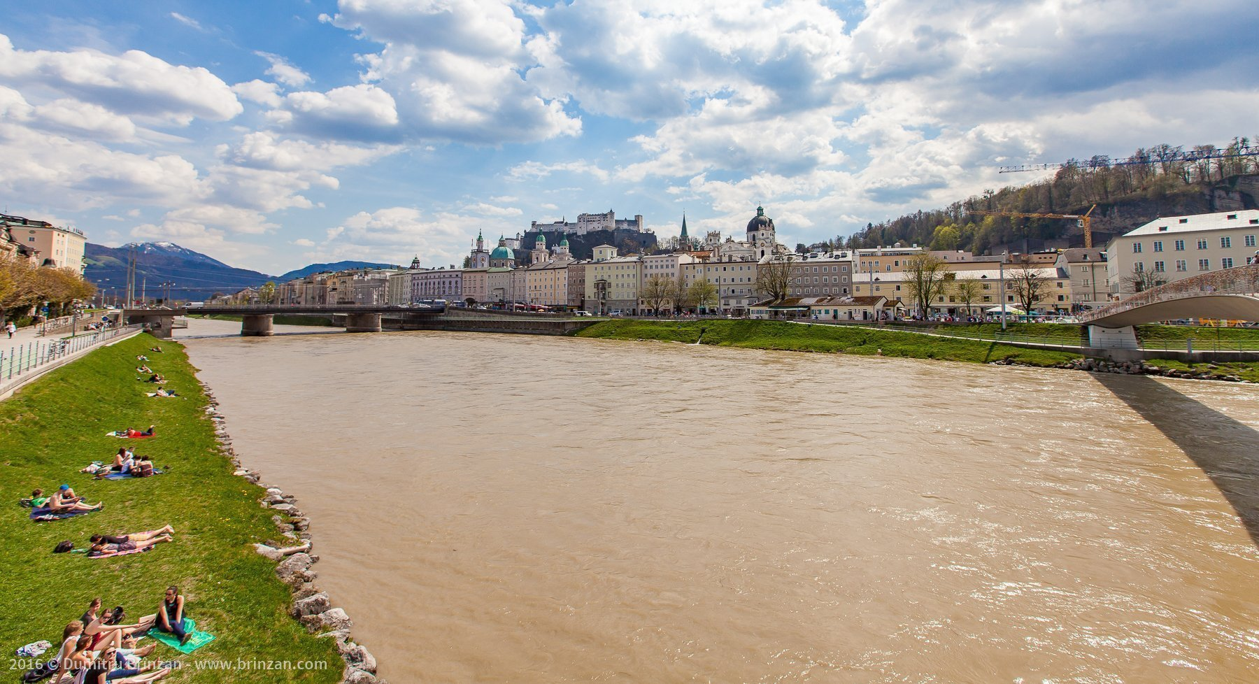 Salzburg is pierced by the Salzach River. The banks of the river are used for sunbathing.